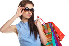 Woman with shopping bags over white Stock Photo