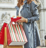 Woman with shopping bags in Paris, France looking into distance Stock Image