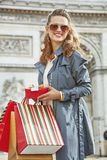 Woman with shopping bags in Paris, France looking into distance Royalty Free Stock Photo
