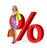 Woman with shopping bags and percent signs Royalty Free Stock Photos