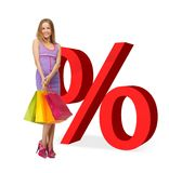Woman with shopping bags and percent signs Stock Photos