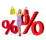 Woman with shopping bags and percent signs Royalty Free Stock Images