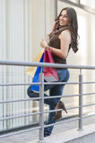 Woman with shopping bags on the phone Royalty Free Stock Photography
