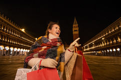 Woman with shopping bags pointing on something while in Venice Royalty Free Stock Photo