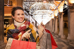 Woman with shopping bags pointing on something in Venice Royalty Free Stock Image