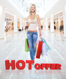 Woman with shopping bags poses at store Stock Photography