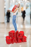 Woman with shopping bags poses at store Royalty Free Stock Photo