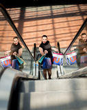 Woman with shopping bags posing on escalator at shopping mall Royalty Free Stock Photography