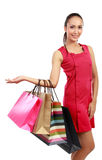 Woman with shopping bags presenting Royalty Free Stock Images