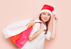 Woman with shopping bags in Santa Claus Royalty Free Stock Images