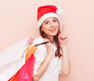 Woman with shopping bags in Santa Claus Stock Photo