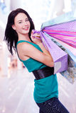 Woman with shopping bags at shop Stock Photo