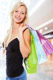 Woman with shopping bags at shop Stock Images