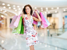 Woman with shopping bags at shop Stock Image