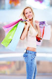 Woman with shopping bags at shop Royalty Free Stock Photos