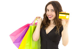 Woman with shopping bags showing credit card Royalty Free Stock Photography