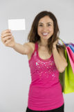 Woman with shopping bags showing sign card Royalty Free Stock Photography