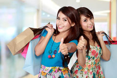 Woman with shopping bags showing thumb up Royalty Free Stock Photography