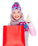 Woman with  shopping bags shows thumbs up sign Stock Photo