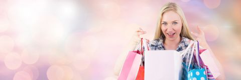 Woman shopping with bags and sparkling lights bokeh transition Stock Image