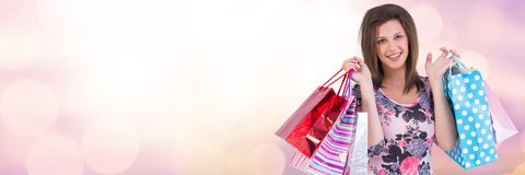Woman shopping with bags and sparkling lights bokeh transition Stock Images