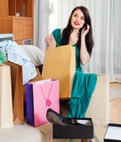 Woman with shopping bags speaking by mobile Royalty Free Stock Images