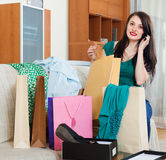 Woman  with shopping bags speaking by mobile Royalty Free Stock Image