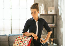 Woman with shopping bags standing in apartment Stock Image