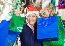 Woman With Shopping Bags Standing At Christmas Stock Images