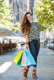 Woman with shopping bags standing on street near Sagrada Familia Stock Image