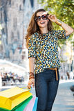 Woman with shopping bags standing on street near Sagrada Familia Stock Photography