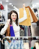 Woman with shopping bags at store Royalty Free Stock Images