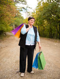 Woman with shopping bags in the street Stock Image
