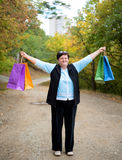 Woman with shopping bags in the street Stock Photos