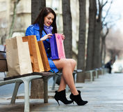 Woman with shopping bags at street Royalty Free Stock Photos