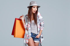 Woman with shopping bags. Studio shoot Stock Photography
