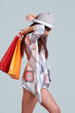 Woman with shopping bags. Studio shoot Royalty Free Stock Images