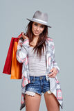 Woman with shopping bags. Studio shoot Stock Photo