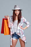 Woman with shopping bags. Studio shoot Royalty Free Stock Photo