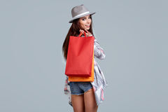 Woman with shopping bags. Studio shoot Stock Photos