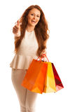 Woman with shopping bags after a successful purchase showing thu Stock Photos