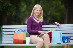 Woman With Shopping Bags And Tablet PC Outdoors Stock Photography
