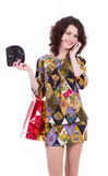 Woman with shopping bags talking on cell phone Royalty Free Stock Images