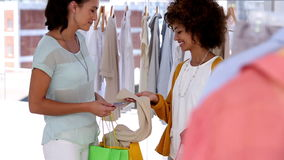 Woman with shopping bags talking with a friend stock footage
