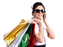 Woman with shopping bags talking on the mobile. Stock Image