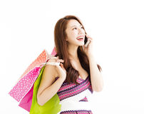 Woman with shopping bags and talking on the phone Royalty Free Stock Photo