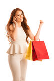 Woman with shopping bags talking on smart phone after a successf Stock Photos