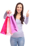 Woman with shopping bags and thumbs up Stock Images