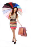 Woman with shopping bags and umbrella Royalty Free Stock Photos