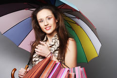 Woman with shopping bags and umbrella Royalty Free Stock Photo